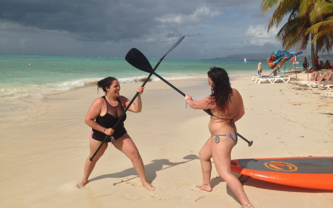 Two good friends learn to Stand Up Paddle in Tobago